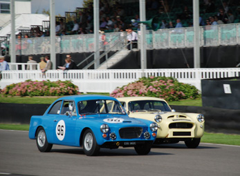 Mike Bell's GT head to head with a Peerless during practice at the 2014 Goodwood Revival
